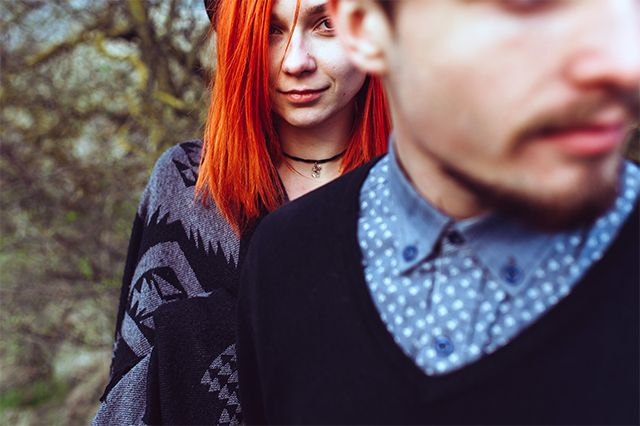 woman with red hair looking at boyfriend