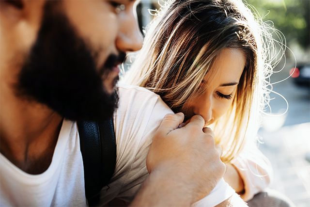 blonde woman holds bearded boyfriend